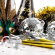 Mask and party hats for New Years Eve - Stock Photo
