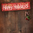 Stock Photo: Bright holiday sign on wooden wall