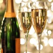 Glasses of champagne and bottle - Stock Photo