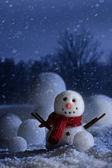 Snowman with wintery background — Stock Photo