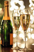 Glasses of champagne and bottle — Stock Photo
