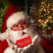Santa Claus with holiday background — Stok fotoğraf