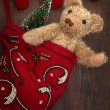 Antique teddy bear in stocking - Stock Photo
