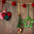 Christmas ornaments hanging on wood — Stock Photo