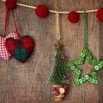 Christmas ornaments hanging on wood — Stock Photo