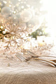 Elegantly lit holiday table with focus on pearl beads and utensi — Stock Photo
