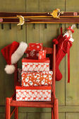 Red chair with holiday gifts — Stock Photo