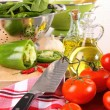 Fresh tomatoes and green peppersl on counter - Stock Photo