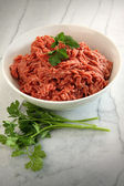 Close up of raw ground beef on cutting board — Stock Photo