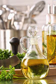 Bottle of olive oil and fresh parsley — Stock Photo