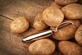 Harvest potatoes on wood — Stock Photo