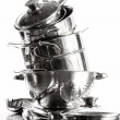Stack with stainless steel pots and pans on white — Stockfoto