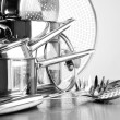 Stainless steel pots and untensils on table - Foto Stock