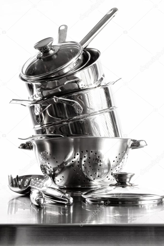 Stack with stainless steel pots and pans on white background — Stock Photo #19277341