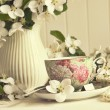 Green apples with blossoms on table - ストック写真