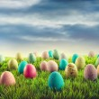 图库照片: Easter eggs in grass
