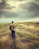 Man walking down country road — Stock Photo