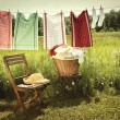 Washing day with laundry on clothesline — Stockfoto
