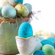 Easter scene with turquoise speckled egg in cup — Stock Photo #3402997