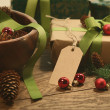 Gift with tag for the holidays on wood table — 图库照片