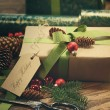 Gifts with tag for the holidays on wood table — Stock Photo