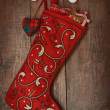 Christmas ornaments in stocking hanging on wood — Stockfoto
