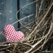 Stock Photo: Little heart on Christmas wreath