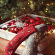 Stockings and ornaments ready to decorate the christmas tree — Stock Photo