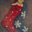 Small teddy bear in stocking for Christmas — Stok fotoğraf