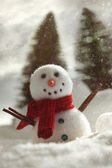 Little snowman with wintery snow background — Stock Photo