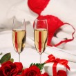 Closeup of champagne glasses and roses — Stock Photo