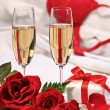 Stock Photo: Champagne glasses and roses to celebrate Valentine's Day