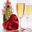 Stock Photo: Glasses of champagne for Valentines day with heart and ribbons