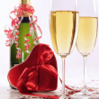 Glasses of champagne for Valentines day with heart and ribbons — Stock Photo