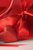 Closeup of hearts and red ribbons — Stock Photo