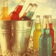Stock Photo: Cool drinks in ice bucket at the beach with vintage look