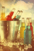 Cool drinks in ice bucket at the beach with vintage look — Stock Photo