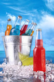 Summer drinks in ice bucket on the beach — Stock Photo