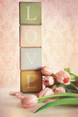 Colored blocks with tulips with vintage look — Stock Photo