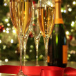 Glasses of champagne with red ribbon — Stock Photo #4340498