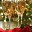 Glasses of champagne and red roses — Stock Photo #4438973