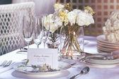 Invitation card on outdoor wedding table — Stock Photo