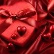 Box of chocolates with ribbons and hearts — Stock Photo #4640121