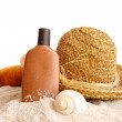 Straw hat with towel and suntan lotion on white — Stock Photo