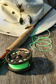 Close-up of fly-fishing reel and rod with hat — Foto de Stock
