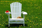 Slice of watermelon on adirondack chair — Stock Photo
