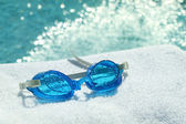 Swimming goggles on towel — Stock Photo
