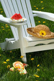 Closeup of slice of watermelon on adirrondack chair — Stockfoto