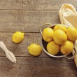 Fresh lemons on wooden counter — Stock Photo #50526711