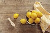 Fresh lemons on wooden counter — Stock Photo